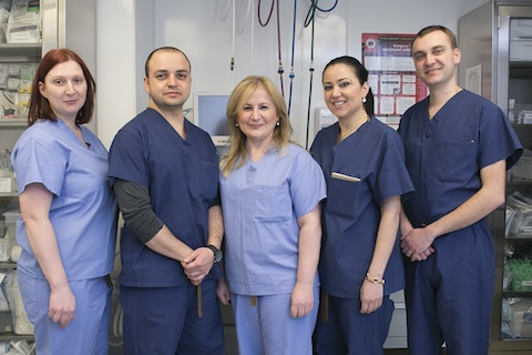Dr. Elena Ocher (C) and her staff at her Mahnattan pain management clinic, Elena Orcher Medical, Feb. 18, 2015. (Samira Bouaou/Epoch Times)
