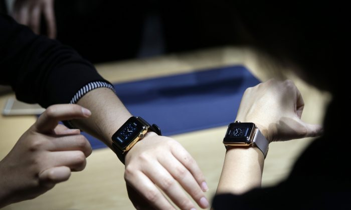 Event attendees get a look at varieties of the new Apple Watch on display in the demo room after an Apple event on Monday, March 9, 2015, in San Francisco.  (AP Photo/Eric Risberg)