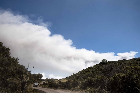 :Ash spewed from the Turrialba volcano heads towards San Jose and its surroundings on March 13, 2015. The volcano showered nearby towns with ash forcing evacuations from areas in its vicinity about 80 km from the crater. (AFP PHOTO / EZEQUIEL BECERRA)