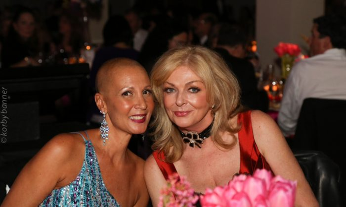 Eight-time cancer survivor Dionne Warner (L) poses with women's cancer care advocate Sherry Abbott on Nov. 22, 2014, at Mirror Ball, an annual fundraising gala in support of people affected by cancer. Warner is a participant in the Look Good Feel Good program, which is dedicated to improving the self-esteem of patients undergoing cancer treatment. (Courtesy Sherry Abbott)