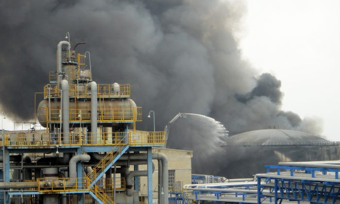 Firefighters attempt to extinguish a fire at PetroChina's oil refinery in Dalian on August 29, 2011. Liao Yongyuan, General Manager of PetroChina, has been taken away for an investigation. (STR/AFP/Getty Images)