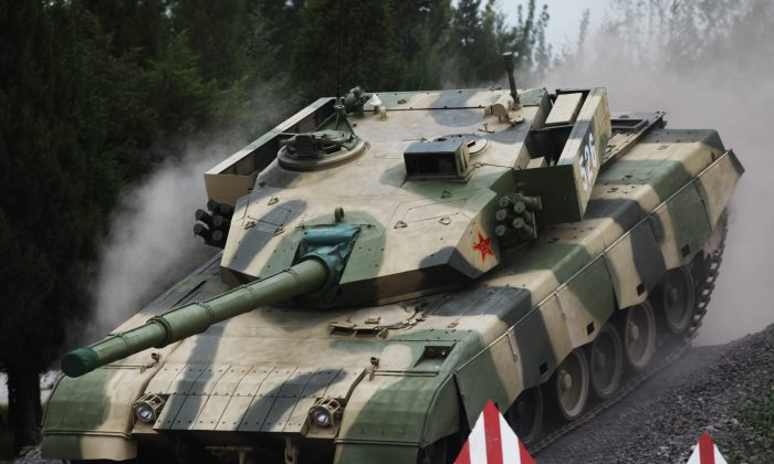 A tank is put on display at the Academy of Armored Forces Engineering of the PLA on July 22, 2014 in Beijing, China. At a recent Chinese military exercise, an entire battalion of tanks broke down in two days time. (ChinaFotoPress/ChinaFotoPress via Getty Images)