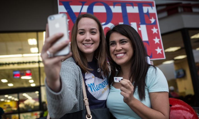Lauren Koepp and Kara Smyth pose for a photo after casting their votes on Election Day early Tuesday morning, Nov. 4, 2014 in Austin, Texas. (AP Photo/Tamir Kalifa)