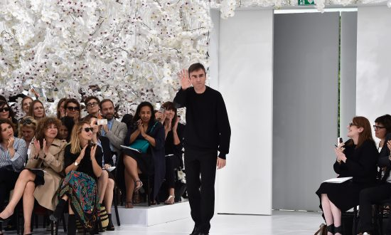 Designer Raf Simons acknowledges the applause of the audience after the  Christian Dior show as part 5e8d000d36b51