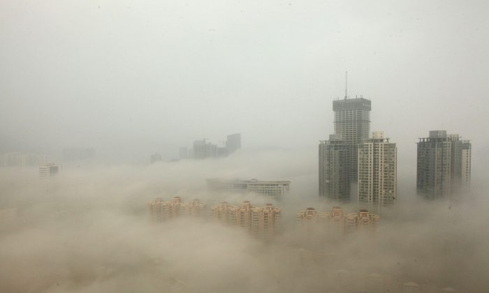 Buildings are shrouded in smog on December 8, 2013 in Lianyungang, China.  (Photo by ChinaFotoPress/Getty Images)