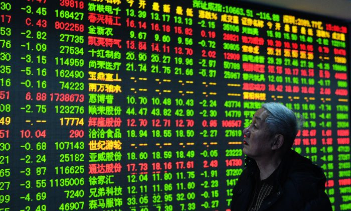 A trader checks share prices at a security firm in Hangzhou, east China's Zhejiang province, on Dec. 30, 2014. China's stock rally will likely see intense turbulence in the near future. (STR/AFP/Getty Images)