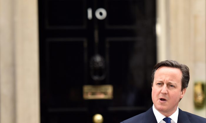 British Prime Minister David Cameron makes a statement outside 10 Downing Street in London on March 30, 2015 after an audience with Queen Elizabeth II to disolve parliament. (Leon Neal/AFP/Getty Images)