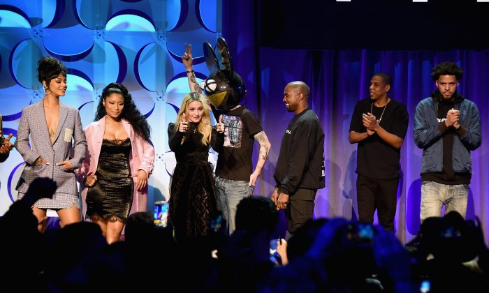 (L-R) Rihanna, Nicki Minaj, Madonna, Deadmau5, Kanye West, JAY Z, and J. Cole onstage at the Tidal launch event #TIDALforALL at Skylight at Moynihan Station on March 30, 2015 in New York City. (Jamie McCarthy/Getty Images for Roc Nation)