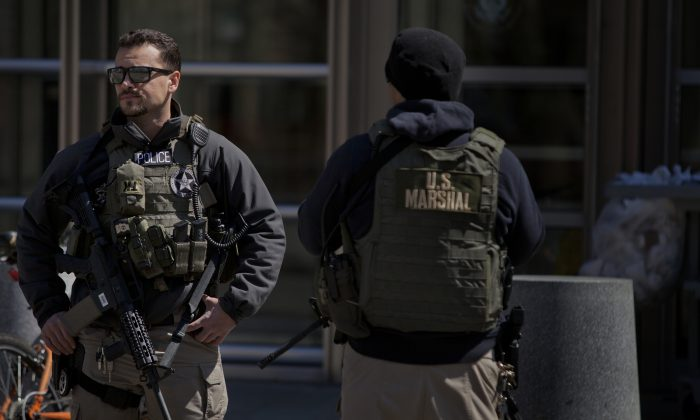 U.S. Marshals stand outside U.S. Federal Court in Brooklyn during the arraignment on terrorism charges of two Queens women, identified as 28-year-old Noelle Velentzas and 31-year-old Asia Siddiqui, as well as American citizen and accused Al Queda member Muhanad Mahmoud al Farekh, 29, April 2, 2015 in New York City. (Victor J. Blue/Getty Images)