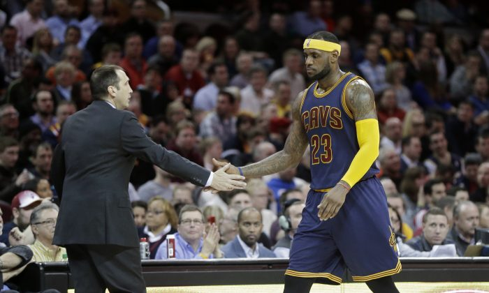 Cleveland Cavaliers' LeBron James (23) is congratulated by head coach David Blatt in an NBA basketball game against the Boston Celtics Tuesday, March 3, 2015, in Cleveland. (AP Photo/Mark Duncan)