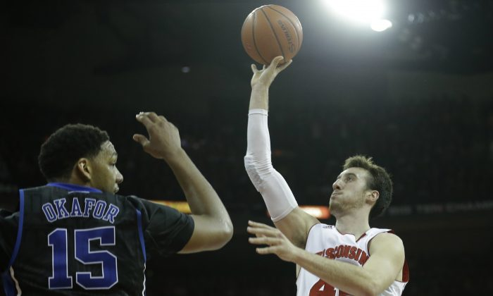 Frank Kaminsky (R) of Wisconsin will have to have a big game against Duke and Jahlil Okafor to bring home the title. (Mike McGinnis/Getty Images)