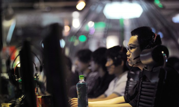 This photo taken on May 12, 2011 shows people at an internet cafe in Beijing. China turns 10 million students into online propagandists. (Gou Yige/AFP/Getty Images)