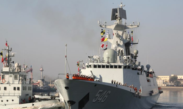 A Chinese missile frigate, the Yancheng, is shown on November 30, 2013, in Qingdao, China, prior to a deployment to the Gulf of Aden. The Chinese regime will now station several warships in the Gulf of Aden. (STR/AFP/Getty Images)