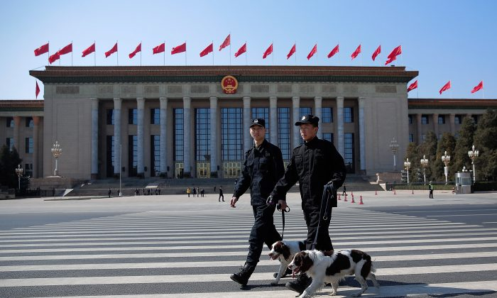 Two policeman with dogs guard the front of the Great Hall of the People in Beijing on MArch 13, 2015. (Lintao Zhang/Getty Images)