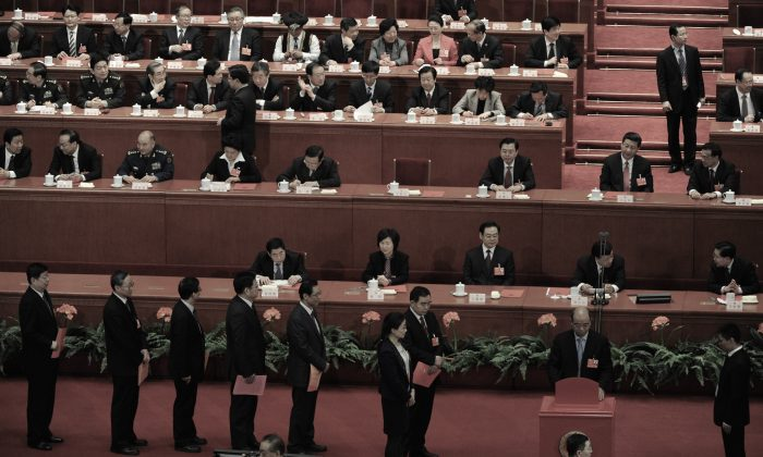 Delegates vote during the election of the new chairman of China during the 12th National People's Congress (NPC) in Beijing on March 14, 2013. Party investigators in Shanxi Province have recently conducted a purge. (Mark Ralston/AFP/Getty Images)