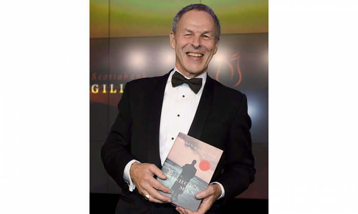 "Author Linden MacIntyre poses with his novel ""The Bishop's Men"" at the Giller Prize gala in 2009. MacIntyre, former host of the CBC's ""The Fifth Estate,"" is one of three authors participating in the Crime and Punishment discussion during the Ottawa International Writers Festival. (The Canadian Press/Darren Calabrese)"