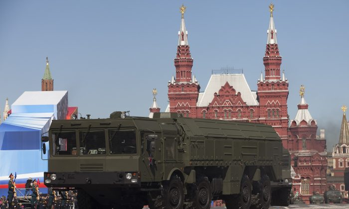 In this Tuesday, May 7, 2013 file photo, Russian Iskander missiles make their way through Red Square during a rehearsal for the Victory Day military parade in Moscow, Russia.  (AP Photo/Alexander Zemlianichenko, File)