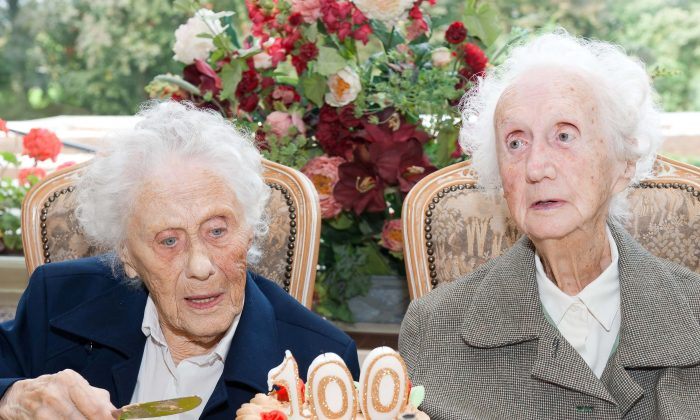 Marie Hendrix (L) and Gabrielle Vaudremer, 100-year-old Belgian twins celebrate their birthday. (Nicolas Lambert/AFP/Getty Images)