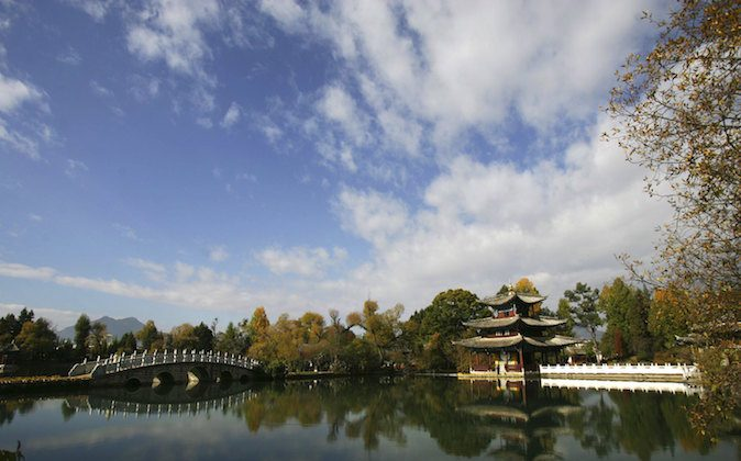 Heilongtan Park in the Lijiang ancient township of Yunnan Province, China, on Nov. 24, 2006. (China Photos/Getty Images)