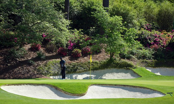 Tiger Woods of the United States hits a shot on the 12th hole during the third round of the 2015 Masters Tournament at Augusta National Golf Club on April 11, 2015 in Augusta, Georgia. (Andrew Redington/Getty Images)