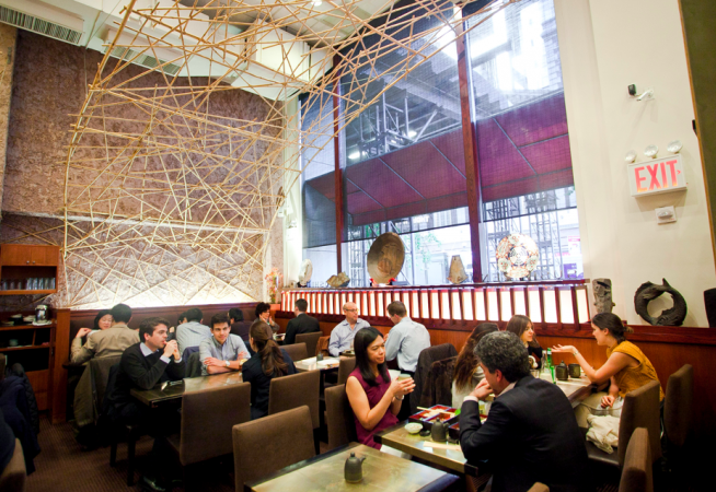 Bamboo lattices arch over the dining room at Sushi Zen. (Samira Bouaou/Epoch Times)