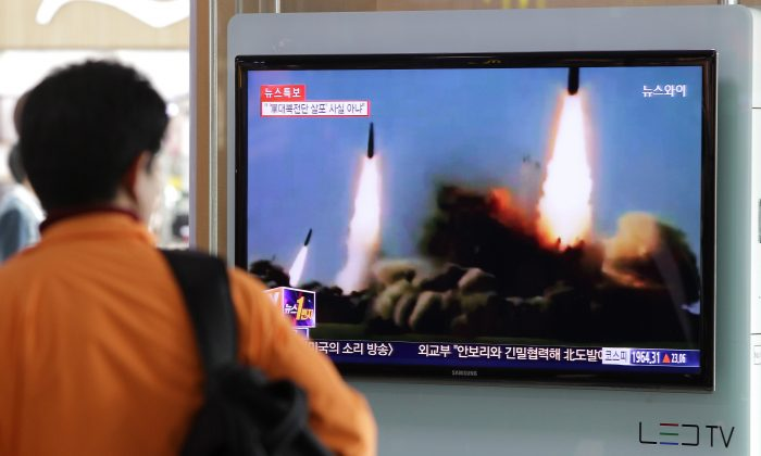 A Man watches a television broadcast in Seoul, South Korea on North Korea's missile launch on March 26, 2014. (Chung Sung-Jun/Getty Images)