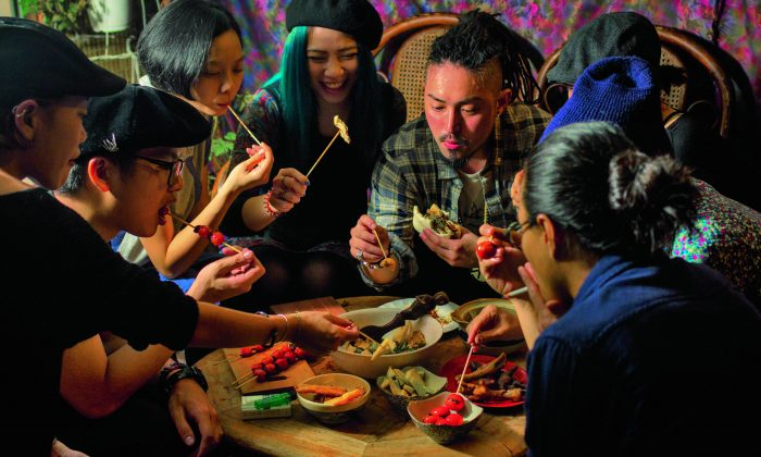 Young diners in Taiwan. (Recipes and photography from THE FOOD OF TAIWAN by Cathy Erway. Copyright © 2015 by Cathy Erway. Photographs by Pete Lee, 2015. Used by permission of Houghton Mifflin Harcourt Publishing Company. All rights reserved.)