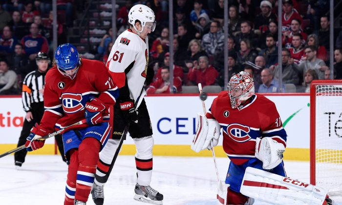 Carey Price stops the puck in front of Tom Gilbert and Mark Stone at the Bell Centre on Dec. 20, 2014 in Montreal, Canada. Montreal and Ottawa renew their rivalry in the NHL Playoffs starting Wednesday, April 15. (Richard Wolowicz/Getty Images)