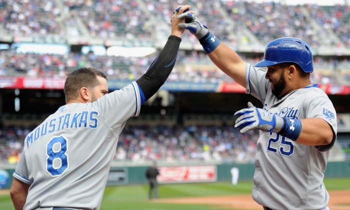 Mike Moustakas of the Kansas City Royals and teammate Kendrys Morales have helped power the team's offense to the best start in the majors. (Hannah Foslien/Getty Images)