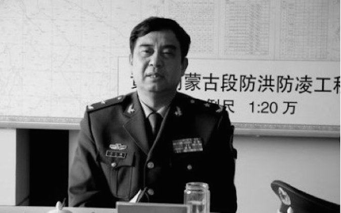 Dong Mingxiang, former chief Beijing Military Region logistics chief, is the latest top military official facing investigation. (Screen shot/Dongfang Daily)