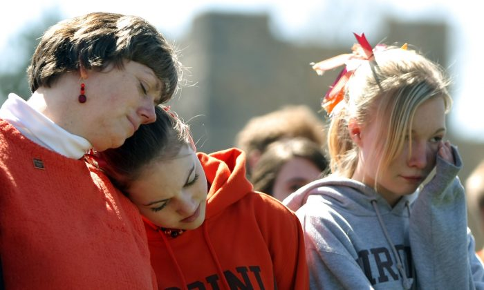 Mourners during Virginia Tech's Day of Remembrance honoring the 32 people killed in a mass shooting one year earlier, in Blacksburg, Va., on April 16, 2008. (Mario Tama/Getty Images)