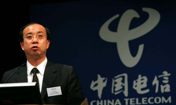 Leng Rongquan, executive director and President of China Telecom Corp., the country's biggest fix-lined telephone operator, speaks during a press conference in Hong Kong Thursday, March 31, 2005. ( AP Photo/Vincent Yu)