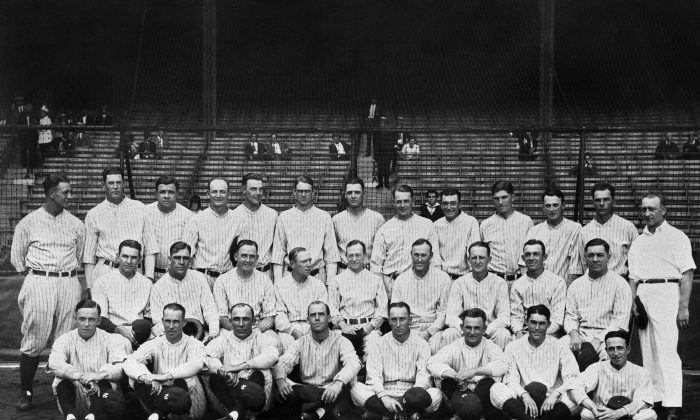 """The 1927 New York Yankees, often mentioned in the same breath with """"one of the best teams of all time."""" Lou Gehrig and Babe Ruth are, respectively, first and third from left in the back row. Manager Miller Huggins is at center, middle row. The batting order, better known as Murderers' Row, led nearly every offensive category in the league. The team finished at 110-44 (.714), 19 games ahead of the second-place Philadelphia Athletics. (AP Photo)"""