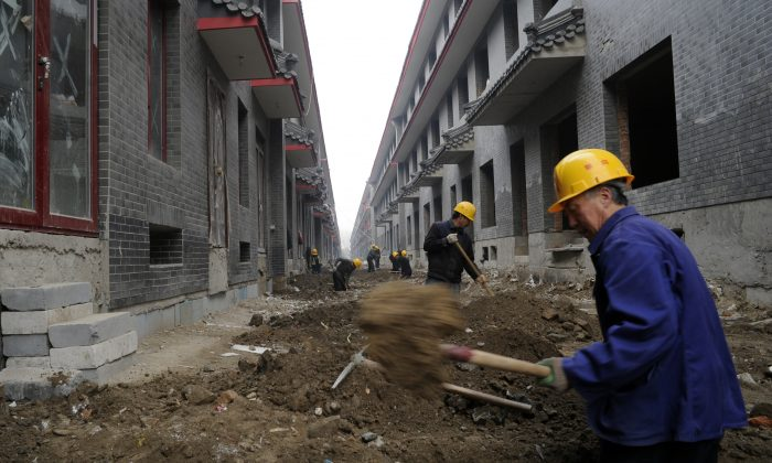 Workers go about their chores at a construction site for new shops in Beijing on November 28, 2011.  (Goh Chai Hin/AFP/Getty Images)