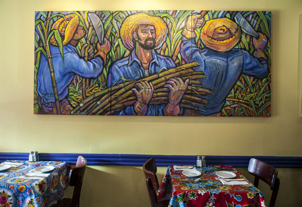 A painting by Presilla's father, at her Hoboken restaurant Cucharamama. (Samira Bouaou/Epoch Times)