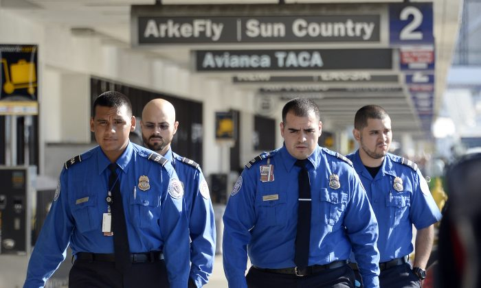 Transportation Security Administration agents walk on the departures level at Los Angeles International Airport November 2, 2013 in Los Angeles, California. (Kevork Djansezian/Getty Images)