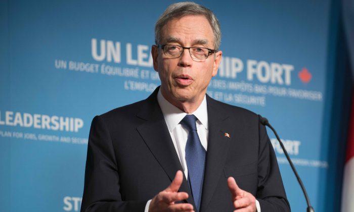Finance minister Joe Oliver addresses the media in Ottawa on April 21, 2015. (Matthew Little/Epoch Times)