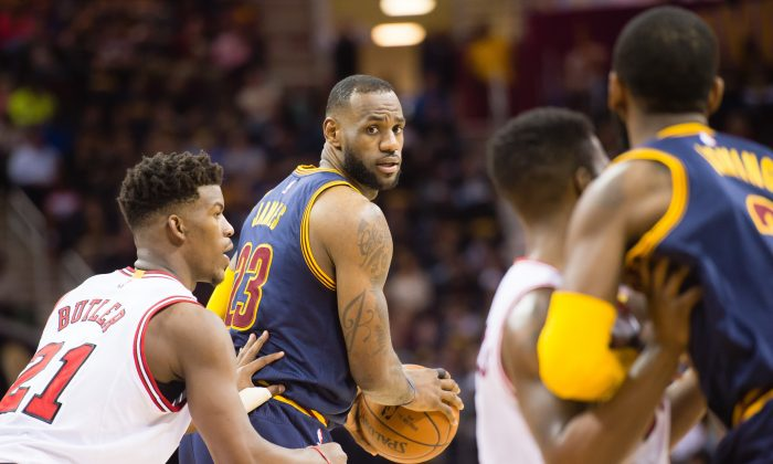 Jimmy Butler (L) and the Chicago Bulls will likely face LeBron James (C) and the Cleveland Cavaliers in a much-anticipated second round matchup. (Jason Miller/Getty Images)