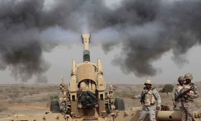 Saudi soldiers fire artillery toward three armed vehicles approaching the Saudi border with Yemen in Jazan, Saudi Arabia, on April 20, 2015. (Hasan Jamali/AP)