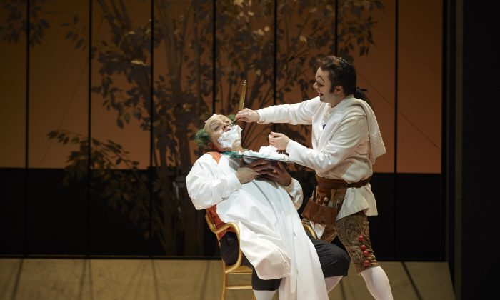 """Renato Girolami as Doctor Bartolo and Joshua Hopkins as Figaro in the Canadian Opera Company production of """"The Barber of Seville."""" (Michael Cooper)"""