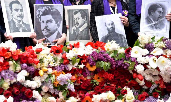 People holding photographs attend a flower laying ceremony at the Tsitsernakaberd Memorial, on April 24, 2015 in Yerevan, Armenia, as part of the Armenian genocide centenary commemoration. Armenians on April 24 marked the centenary of the massacre of up to 1.5 million of their kin  (KIRILL KUDRYAVTSEV/AFP/Getty Images)