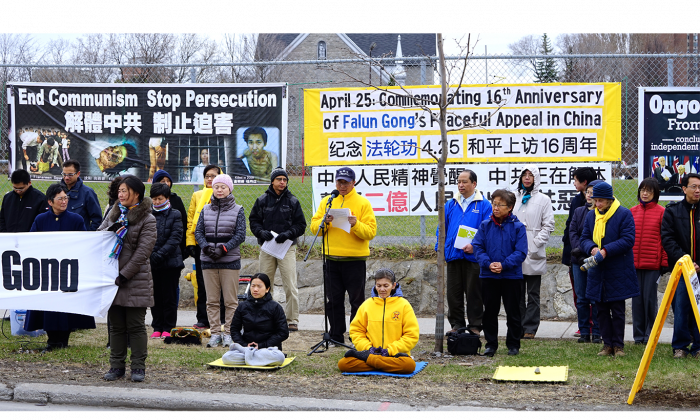 Adherents of Falun Gong, also called Falun Dafa, gather across the street from the Chinese embassy in Ottawa on April 24, 2015, to commemorate the peaceful protest 16 years ago, on April 25, 1999, when 10,000 Falun Gong practitioners gathered in Beijing to call on the central government to allow them to practice their faith free from harassment. (Pam McLennan/Epoch Times)