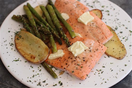 Baked Steelhead Trout with Asparagus, Potatoes and Herbs (AP Photo/Matthew Mead)