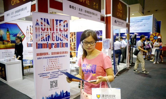A Chinese investor visits an overseas property and immigration exhibition in Beijing on July 4, 2014. (Wang Zhao/AFP/Getty Images)