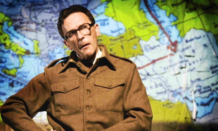 """Matthew Zajac in the one-man play, """"The Tailor of Inverness,"""" uses projected maps to trace possible routes his father took in WWII. (Tim Morozzo)"""