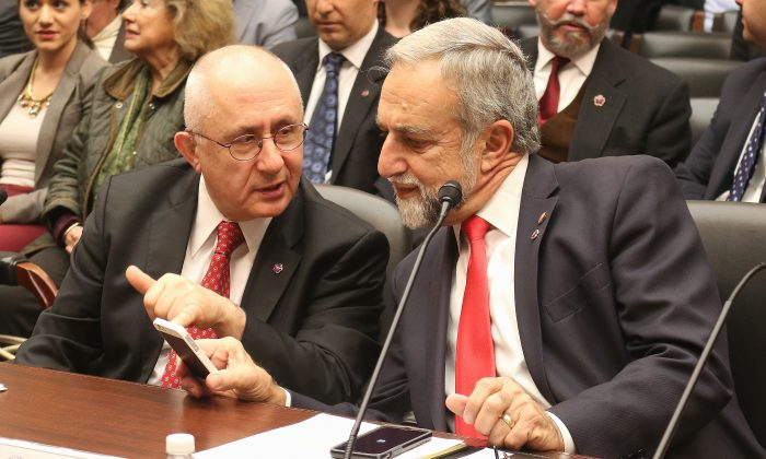 Dr. Taner Akçam (L), professor of history, Clark University converses with Kenneth V. Hachikian, co-chairman, the Armenian National Committee of America, on April 23, at the Helsinki Commission hearing before testifying concerning the Armenian Genocide. (Gary Feuerberg/Epoch Times).