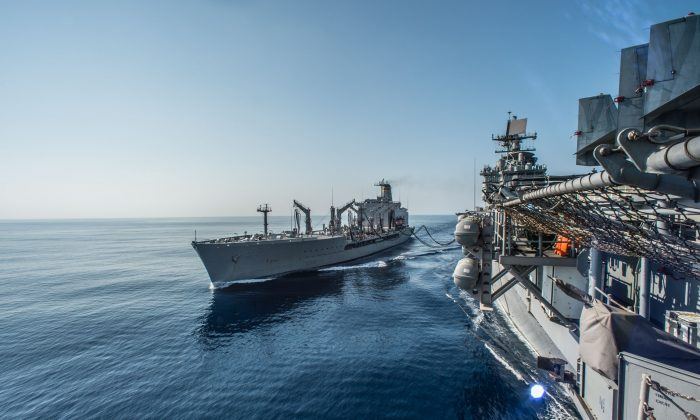 The amphibious assault ship USS Bonhomme Richard (LHD 6) conducts a replenishment-at-sea with the Military Sealift Command fleet replenishment oiler USNS Rappahannock (T-AO 204) in the Luzon Strait, Philippines, on March 1. The United States can now deploy troops to Philippine military bases near the disputed Spratly Islands. (U.S. Navy photo by Mass Communication Specialist 3rd Class Kevin V. Cunningham/Released)