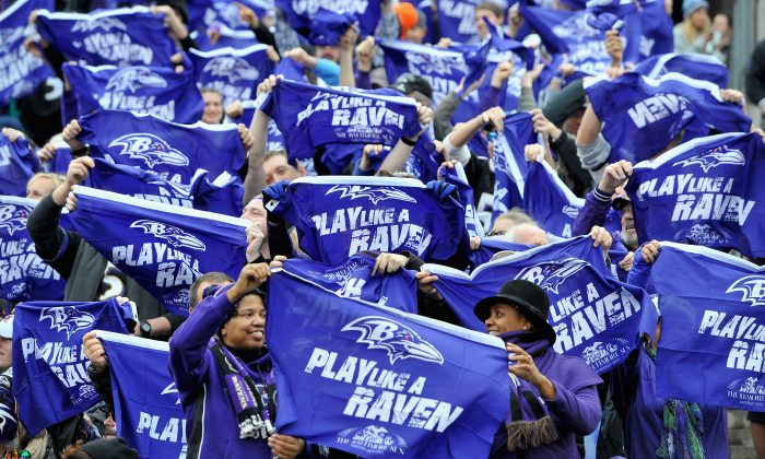 Fans wave flags as the Baltimore Ravens take on the Cleveland Browns at M&T Bank Stadium on December 28, 2014 in Baltimore, Maryland. (Larry French/Getty Images)