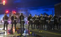 Baltimore on Edge as Curfew Approaches; National Guard Takes Up Posts