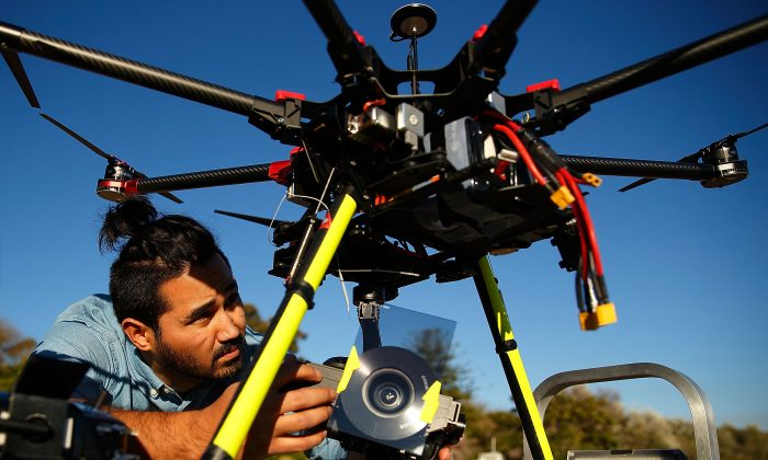 Drone operator, Ken Butti carries out pre-flight checks of the custom built DJI s1000 Drone prior to flight at Palm Beach on July 4, 2014 in Sydney, Australia.(Brendon Thorne/Getty Images)